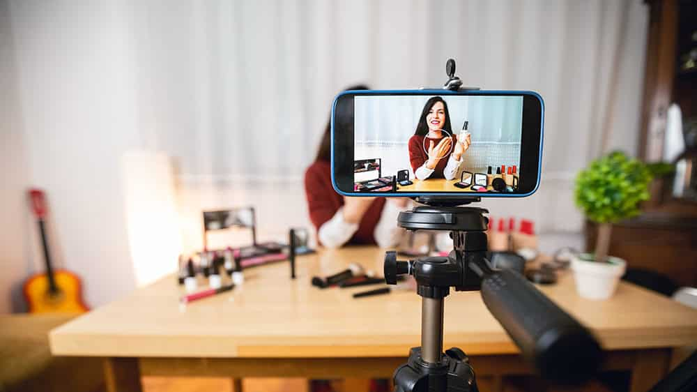Young woman vlogging YouTube
